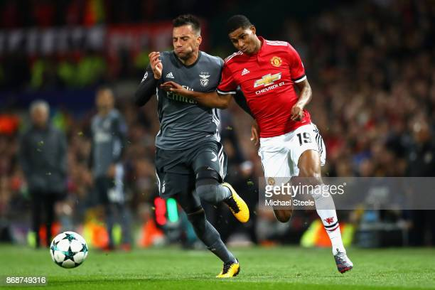 Marcus Rashford of Manchester United and Andreas Samaris of Benfica during the UEFA Champions League group A match between Manchester United and SL...