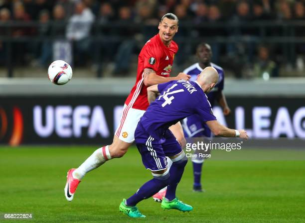 Marcus Rashford of Manchester United and Bram Nuytinck of RSC Anderlecht in action during the UEFA Europa League quarter final first leg match...