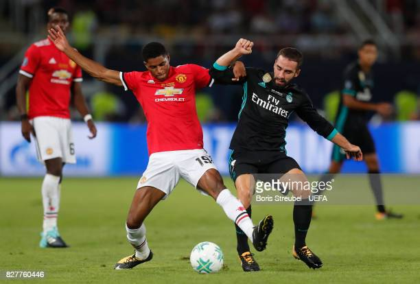 Marcus Rashford of Manchester United and Daniel Carvajal of Real Madrid battle for possession during the UEFA Super Cup final between Real Madrid and...