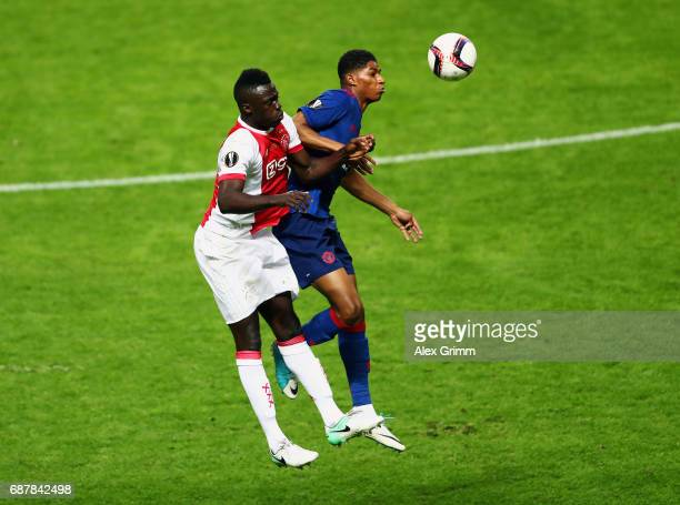 Marcus Rashford of Manchester United and Davinson Sanchez of Ajax in action during the UEFA Europa League Final between Ajax and Manchester United at...