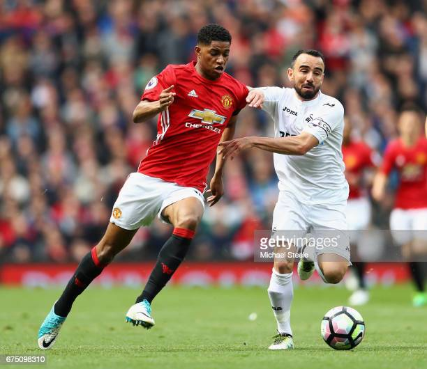 Marcus Rashford of Manchester United and Leon Britton of Swansea City battle for possession during the Premier League match between Manchester United...