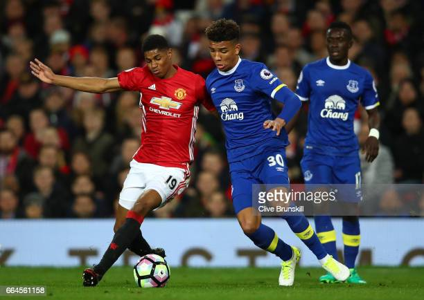 Marcus Rashford of Manchester United and Mason Holgate of Everton battle for possession during the Premier League match between Manchester United and...