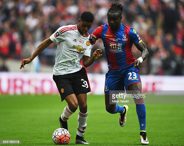 Marcus Rashford of Manchester United and Pape N'Diaye Souare of Crystal Palace battle for the ball during The Emirates FA Cup Final match between...