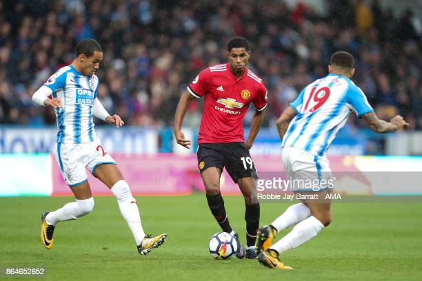 Marcus Rashford of Manchester United and Tom Ince of Huddersfield Town during the Premier League match between Huddersfield Town and Manchester...