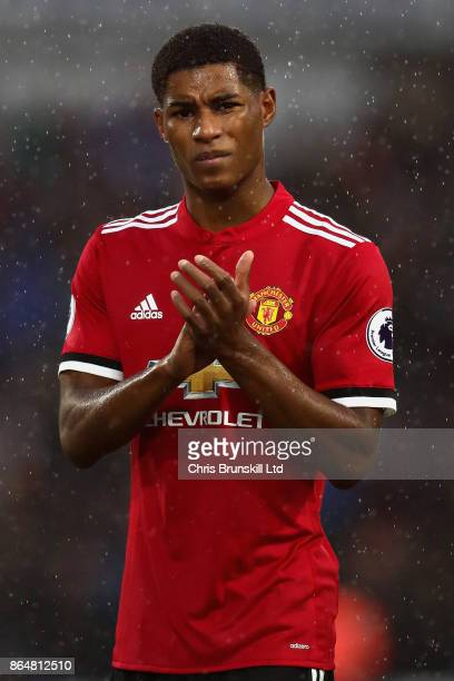 Marcus Rashford of Manchester United applauds the crowd after the Premier League match between Huddersfield Town and Manchester United at John...
