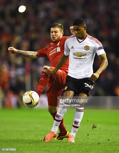 Marcus Rashford of Manchester United battles with Alberto Moreno of Liverpool during the UEFA Europa League Round of 16 first leg match between...