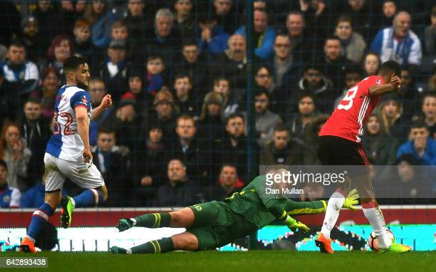 Marcus Rashford of Manchester United beats goalkeeper Jason Steele of Blackburn Rovers to score their first and equalising goal during The Emirates...