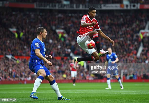 Marcus Rashford of Manchester United beats Phil Jagielka of Everton to the ball during the Barclays Premier League match between Manchester United...