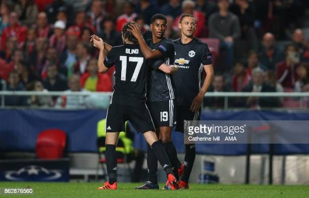 Marcus Rashford of Manchester United celebrates after he scores a goal to make it 01 during the UEFA Champions League group A match between SL...