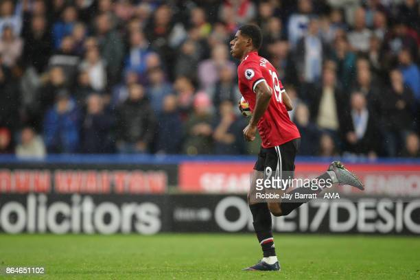 Marcus Rashford of Manchester United celebrates after scoring a goal to make it 21 during the Premier League match between Huddersfield Town and...