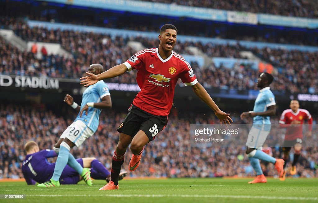 Marcus Rashford of Manchester United celebrates as he scores their first goal during the Barclays Premier League match between Manchester City and Manchester United at Etihad Stadium on March 20, 2016 in Manchester, United Kingdom.