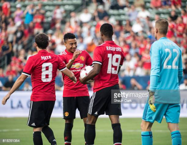 Marcus Rashford of Manchester United celebrates his goal with Juan Mata and Jesse Lingard of Manchester United during the Los Angeles Galaxy's...