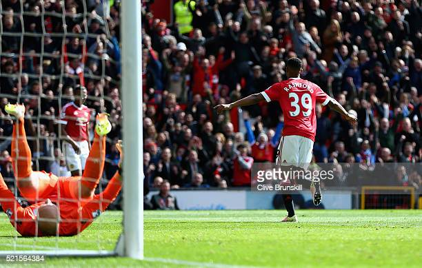 Marcus Rashford of Manchester United celebrates scoring his sides first goal during the Barclays Premier League match between Manchester United and...