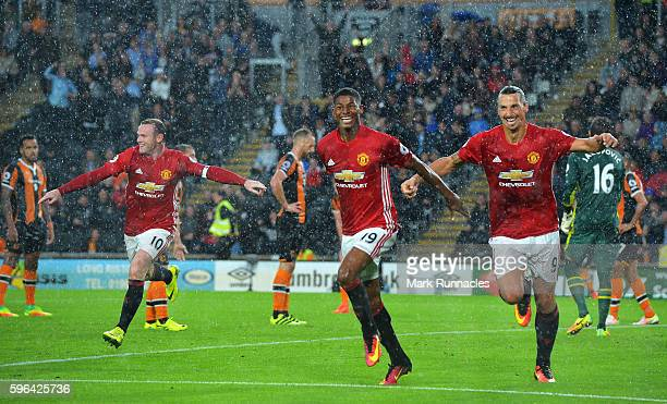 Marcus Rashford of Manchester United celebrates scoring his sides first goal with team mates Wayne Rooney of Manchester United and Zlatan Ibrahimovic...