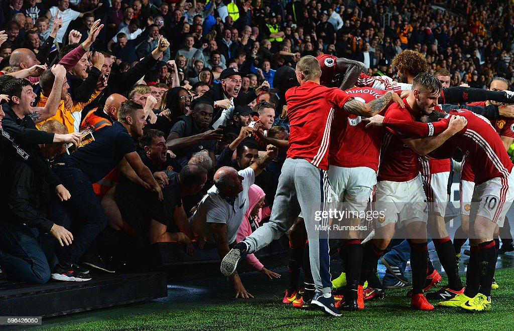Marcus Rashford of Manchester United celebrates scoring his sides first goal with team mates and fans during the Premier League match between Hull City and Manchester United at KCOM Stadium on August 27, 2016 in Hull, England.