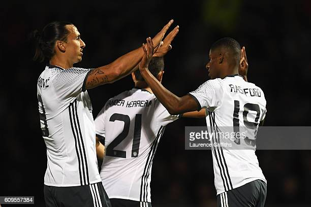 Marcus Rashford of Manchester United celebrates scoring his sides third goal with Zlatan Ibrahimovic of Manchester United during the EFL Cup Third...