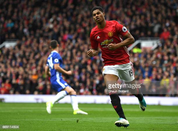 Marcus Rashford of Manchester United celebrates scoring his sides first goal during the Premier League match between Manchester United and Chelsea at...