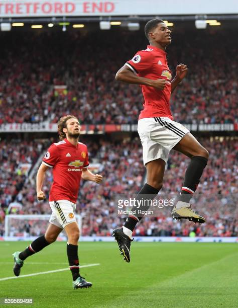 Marcus Rashford of Manchester United celebrates scoring his sides first goal with his Manchester United team mates during the Premier League match...