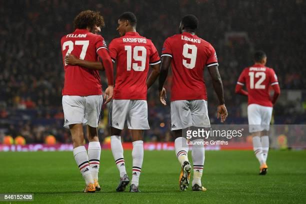 Marcus Rashford of Manchester United celebrates scoring his sides third goal with Marouane Fellaini of Manchester United and Romelu Lukaku of...