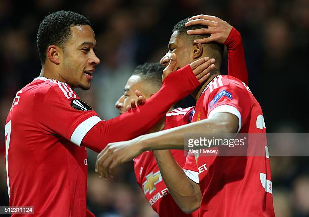 Marcus Rashford of Manchester United celebrates scoring his team's second goal with his team mate Memphis Depay during the UEFA Europa League Round...