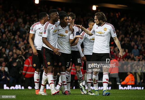Marcus Rashford of Manchester United celebrates scoring the opening goal with team mates during The Emirates FA Cup sixth round replay between West...