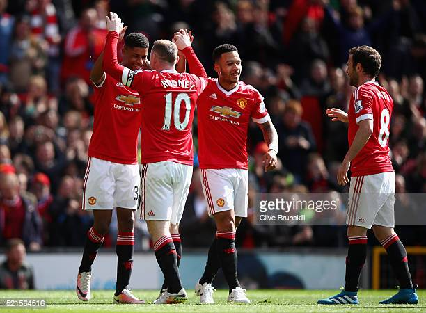 Marcus Rashford of Manchester United celebrates scoring the opening goal with Wayne Rooney of Manchester United during the Barclays Premier League...
