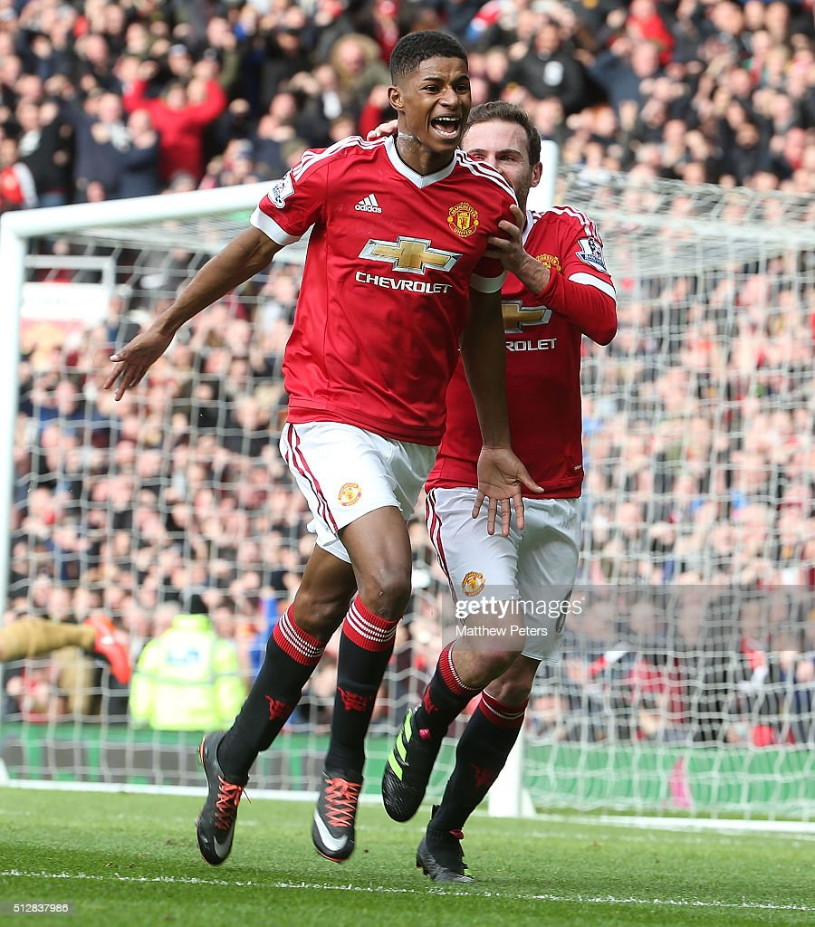 Marcus Rashford of Manchester United celebrates scoring their first goal during the Barclays Premier League match between Manchester United and Arsenal at Old Trafford on February 28 2016 in Manchester, England