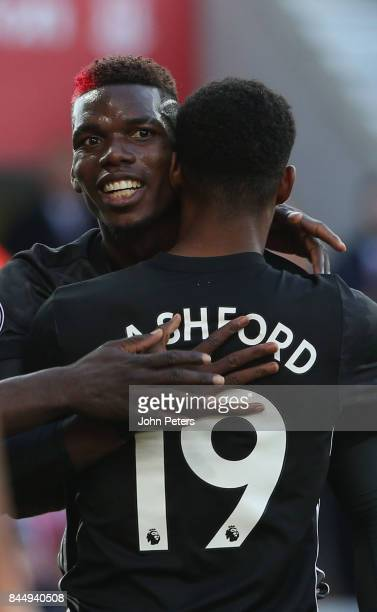 Marcus Rashford of Manchester United celebrates scoring their first goal their first goal during the Premier League match between Stoke City and...