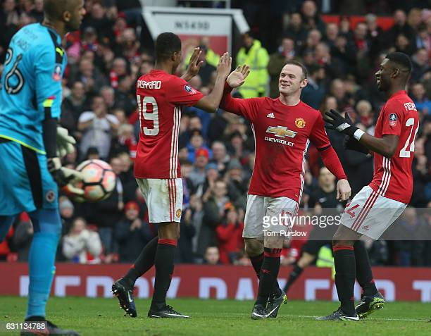 Marcus Rashford of Manchester United celebrates scoring their fourth goal during the Emirates FA Cup Third Round match between Manchester United and...