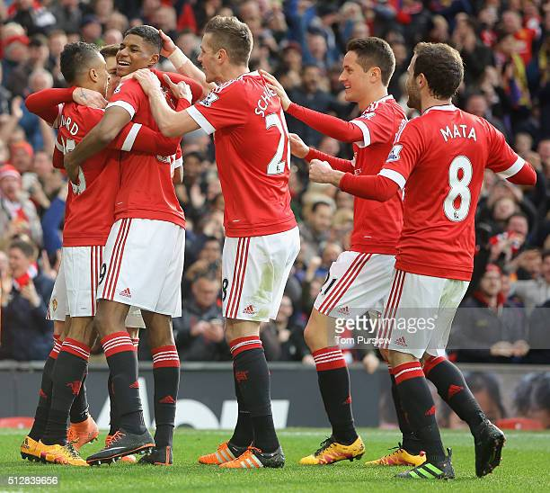 Marcus Rashford of Manchester United celebrates scoring their second goal during the Barclays Premier League match between Manchester United and...