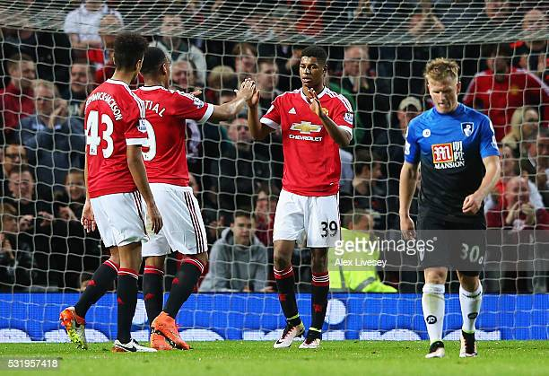 Marcus Rashford of Manchester United celebrates with Anthony Martial and Cameron BorthwickJackson as he scores their second goal during the Barclays...