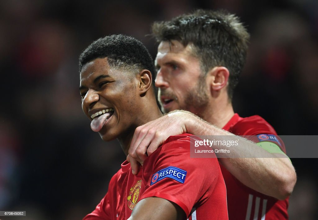 Marcus Rashford of Manchester United celebrates with team mate Michael Carrick as he scores their second goal during the UEFA Europa League quarter final second leg match between Manchester United and RSC Anderlecht at Old Trafford on April 20, 2017 in Manchester, United Kingdom.
