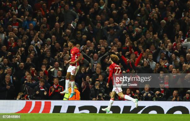 Marcus Rashford of Manchester United celebrates with team mate Marouane Fellaini as he scores their second goal during the UEFA Europa League quarter...