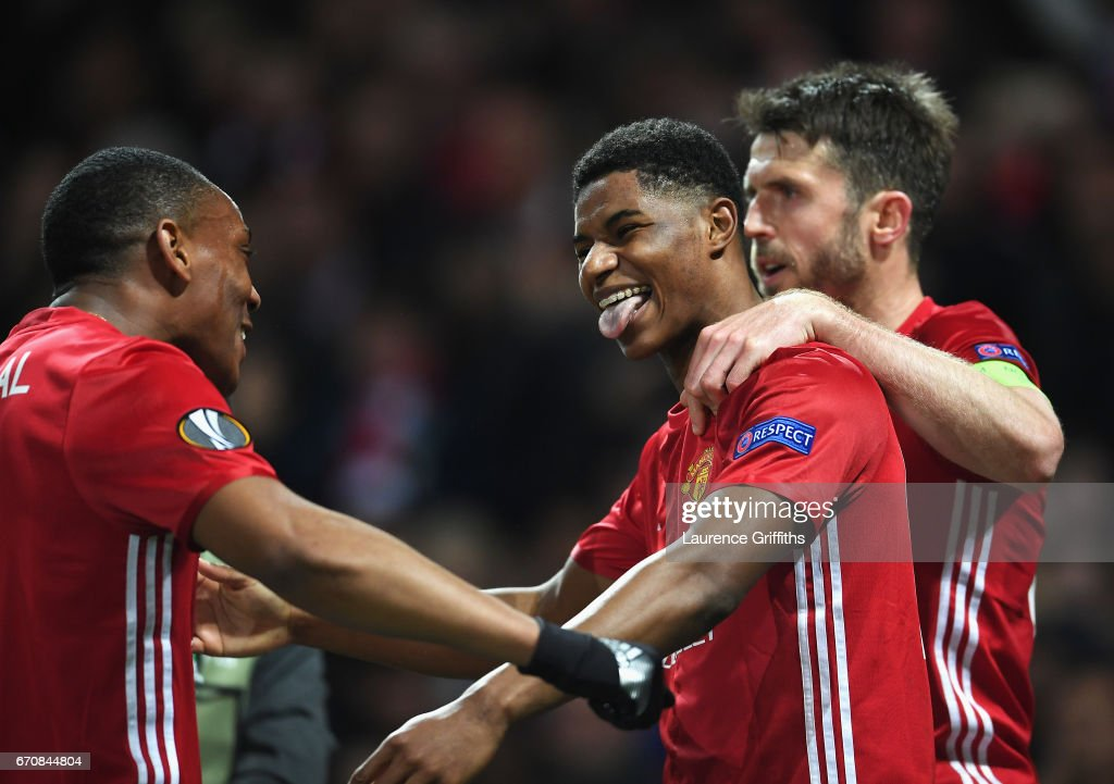 Marcus Rashford of Manchester United celebrates with team mates as he scores their second goal during the UEFA Europa League quarter final second leg match between Manchester United and RSC Anderlecht at Old Trafford on April 20, 2017 in Manchester, United Kingdom.