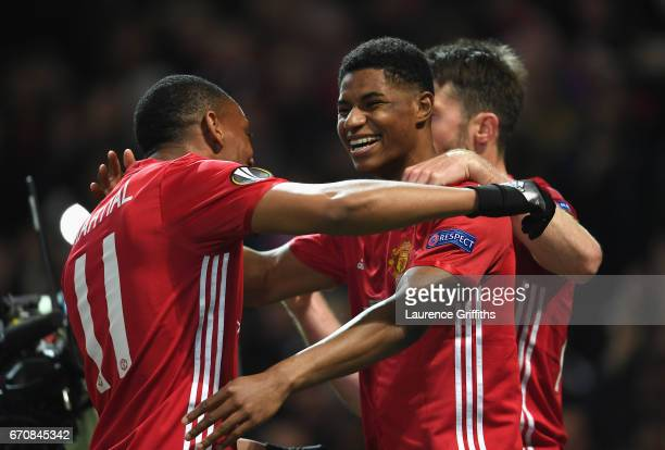 Marcus Rashford of Manchester United celebrates with team mates as he scores their second goal during the UEFA Europa League quarter final second leg...