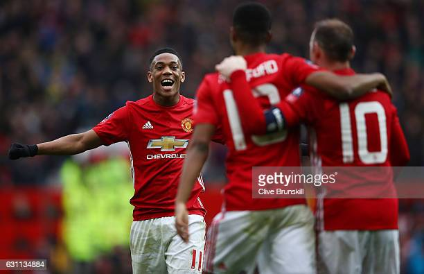Marcus Rashford of Manchester United celebrates with wayne Rooney and Anthony Martial of Manchester United after scoring his first and his sides...