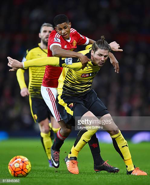 Marcus Rashford of Manchester United challenges Sebastian Prodl of Watford for the ball during the Barclays Premier League match between Manchester...