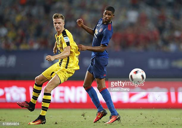 Marcus Rashford of Manchester United competes for the ball with Felix Passlack of Borussia Dortmund during the International Champions Cup match...