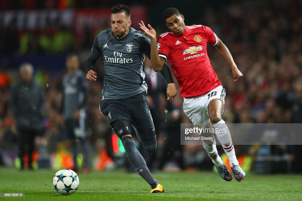 Marcus Rashford of Manchester United competes with Andreas Samaris of Benfica during the UEFA Champions League group A match between Manchester United and SL Benfica at Old Trafford on October 31, 2017 in Manchester, United Kingdom.