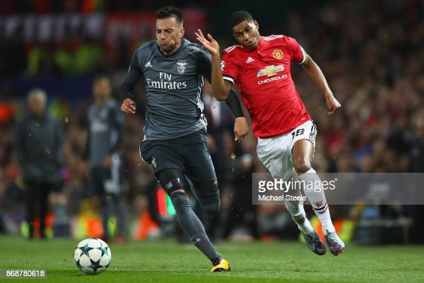 Marcus Rashford of Manchester United competes with Andreas Samaris of Benfica during the UEFA Champions League group A match between Manchester...