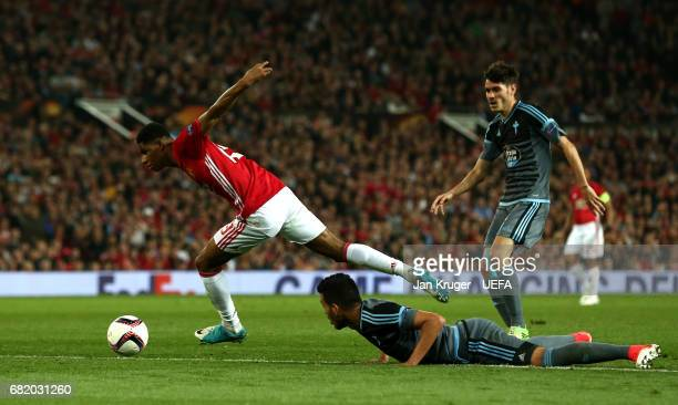 Marcus Rashford of Manchester United goes past Gustavo Cabral of Celta Vigo during the UEFA Europa League semi final second leg match between...