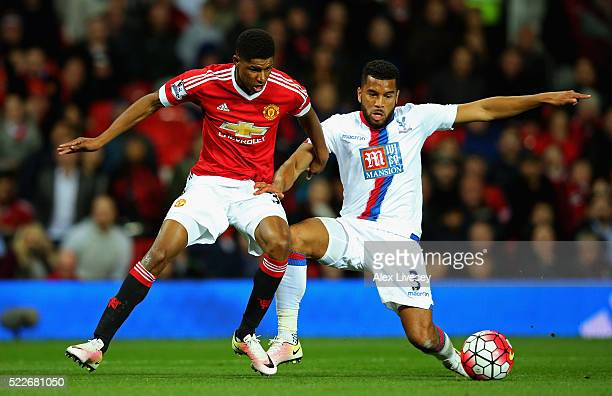 Marcus Rashford of Manchester United holds off Adrian Mariappa of Crystal Palace during the Barclays Premier League match between Manchester United...