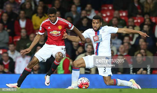 Marcus Rashford of Manchester United in action with Adrian Mariappa of Crystal Palace during the Barclays Premier League match between Manchester...