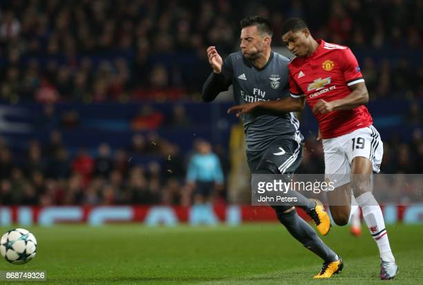 Marcus Rashford of Manchester United in action with Andreas Samaris of Benfica during the UEFA Champions League group A match between Manchester...