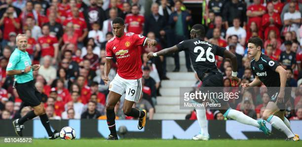 Marcus Rashford of Manchester United in action with Arthur Masuaku of West Ham United during the Premier League match between Manchester United and...