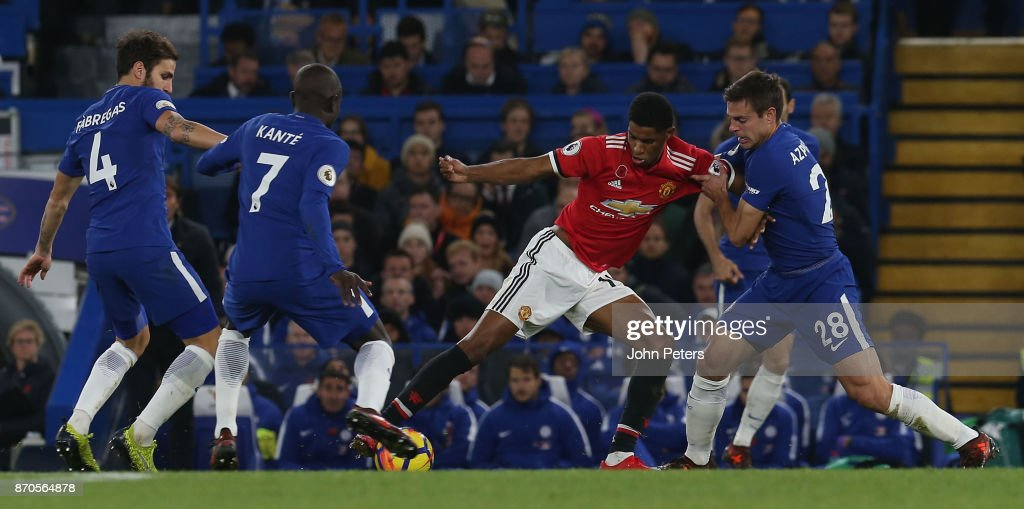 Marcus Rashford of Manchester United in action with Cesar Azpilicueta of Chelsea during the Premier League match between Chelsea and Manchester United at Stamford Bridge on November 5, 2017 in London, England.