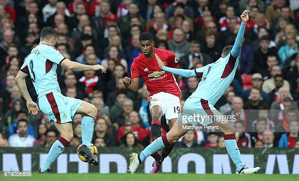 Marcus Rashford of Manchester United in action with Dean Marney and Michael Keane of Burnley during the Premier League match between Manchester...