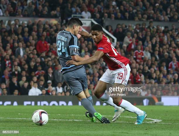 Marcus Rashford of Manchester United in action with Facundo Roncaglia of Celta Vigo during the UEFA Europa League semi final second leg match between...
