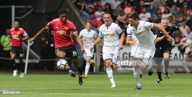Marcus Rashford of Manchester United in action with Federico Fernandez of Swansea City during the Premier League match between Swansea City and...