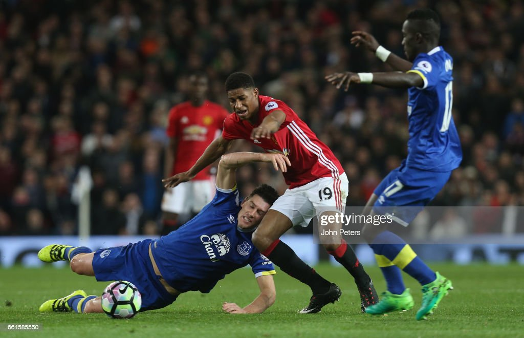 Marcus Rashford of Manchester United in action with Gareth Barry of Everton during the Premier League match between Manchester United and Everton at Old Trafford on April 4, 2017 in Manchester, England.